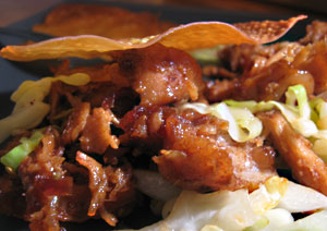 Five spice pulled pork with Asian BBQ sauce, sauteed cabbage and a wonton crisp.