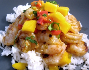 Hot stuff! Shrimp Piri Piri served with diced mango over jasmine rice.