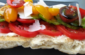 rench bread layered with garlic aioli, heirloom tomatoes, a drizzling of balsamic vinegar and parmesan shavings.